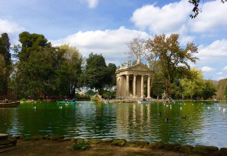 Temple of aesculapius and lake at villa borghese