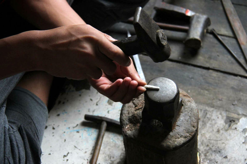 Cropped Image Of Worker Working At Workshop