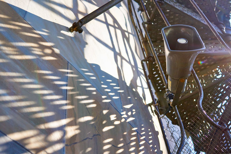 shadow from a loud-hailer loudspeaker which hangs on a spiral staircase under sunshine. Shade darkness and light Loud Loudness Stairs Spiral Stairs Spiral Staircase Darkness Shadow Sunlight Sport Sky Close-up