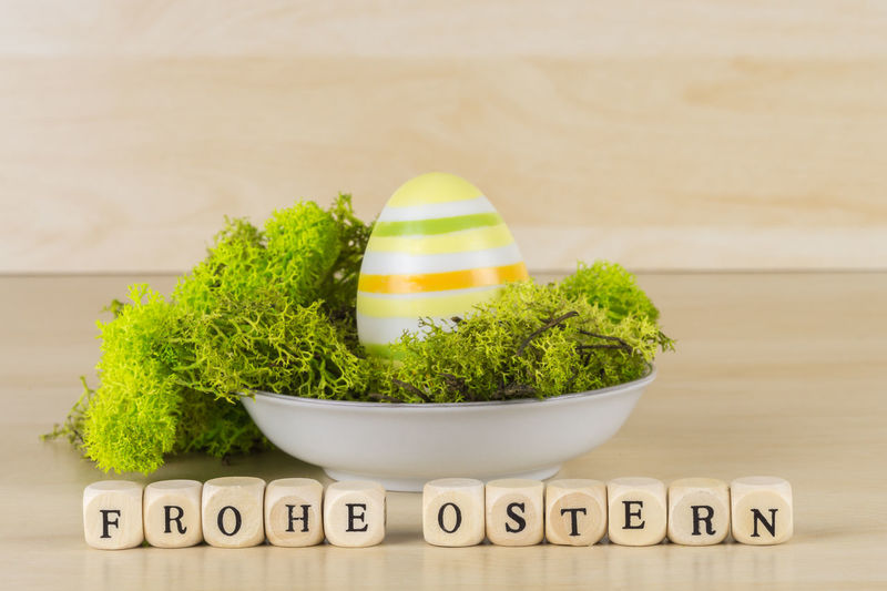 Easter Easter Egg Easter Basket  Frohe Ostern Alphabet Capital Letter Close-up Communication Day Easter Baskets! Egg Food Food And Drink Freshness Green Color Healthy Eating Indoors  Moss No People Single Word Table Text Western Script