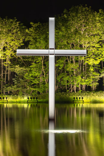 Cross on the water with an inverted reflection in a beautiful nature forest mountain background Christianity Christian Catholicism Sacred Holy Cross Church Chapel Crucifix Christmas Religion Religious  Faith Catholic Symbol Spirituality Bible Belief Forest Mountain Reflection Water Tomamu Hoshino Resorts Hokkaido Japan Architecture Tourism Wedding Reflex Building Structure Sky Nature Green Tree Wooden Travel Design Night ASIA Solemn Famous Destination Church On The Water Chapel On The Water Tadao Ando Beautiful Backgrounds Day
