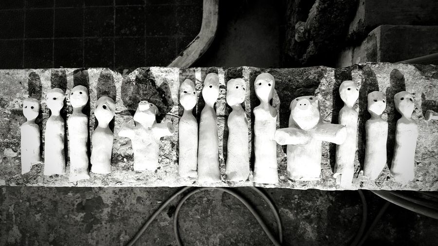 Directly above shot of clay sculptures on table