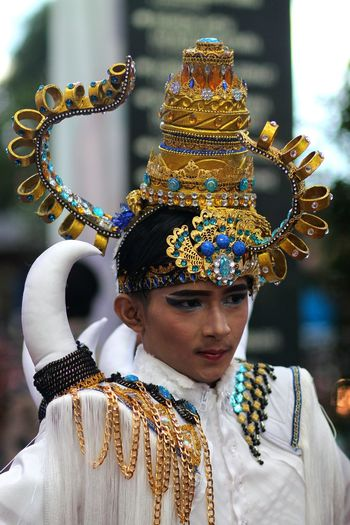 Close-Up Of Young Man Wearing Headdress During Traditional Festival