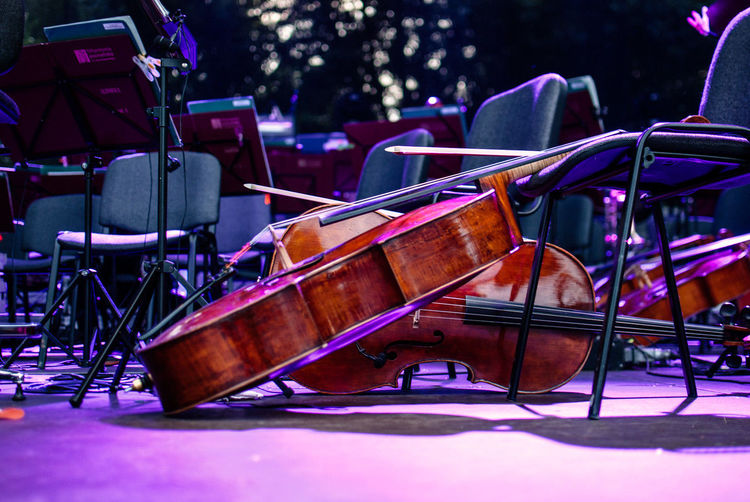 Violins By Empty Chairs On Stage