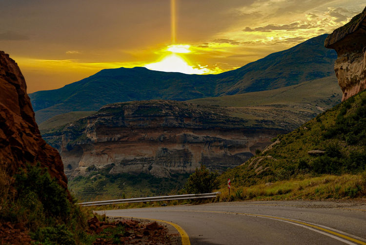 Sunrise over the mountains. Landscape Sunrise Travel Nature Cloud - Sky Highway Dawn Sunset Outdoors Scenics Evening Hill Sun Mountain Multi Colored Sunset Road Yellow Winding Road Sky Landscape Cloud - Sky Mountain Range Mountain Road Rock Formation Canyon Valley Geology Rocky Mountains Cliff