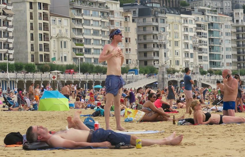 #beachlife #getting A Tan Adult Beach Crowd Leisure Activity Men Real People Shirtless Vacations