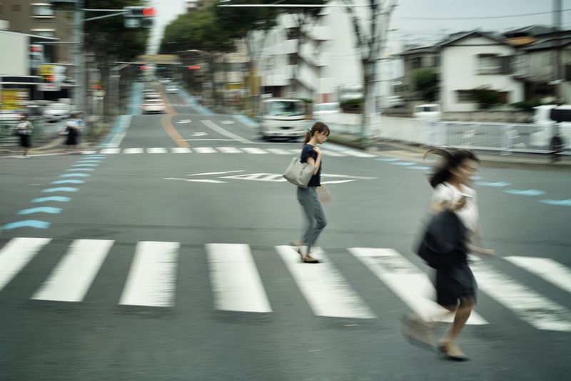 People running on road in city
