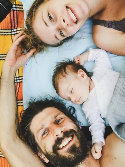 happy young family with a newborn baby Smiling Face Newborn Baby Happy People Touching Moments Real People Real People Child Childhood Togetherness Family Portrait Moments Of Happiness Bonding Parent Headshot Family With One Child Leisure Activity Father Young Men People Mother Positive Emotion