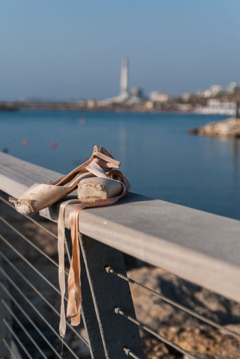 Close-up of rope tied to railing against sea