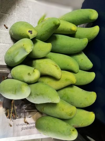 Mango Close-up Day Food Food And Drink For Sale Freshness Fruit Green Color Healthy Eating Indoors  Large Group Of Objects No People Retail