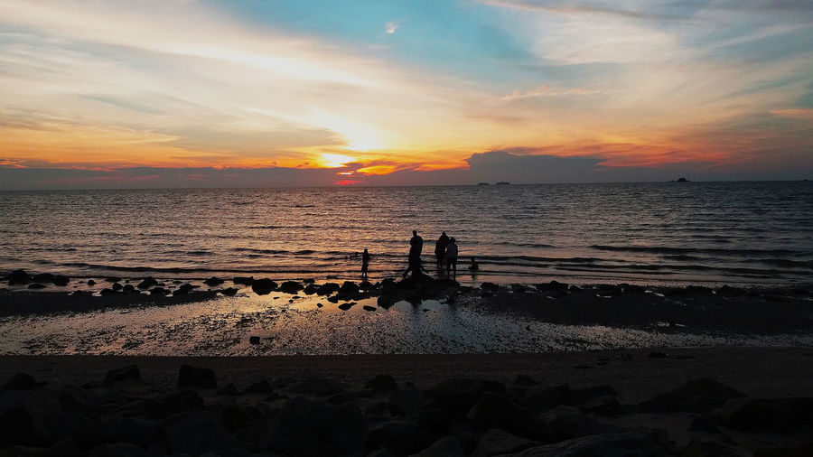 Happy together Beautiful Nature Kuala Selangor Malaysia Peaceful View Remis Beach Beach Beauty In Nature Blue Sky Cloud - Sky Horizon Over Water Idyllic Nature Orange Color Outdoors Sand Scenics Sea Shore Silhouette Sky Sunset Tranquil Scene Tranquility Water Wave Waves