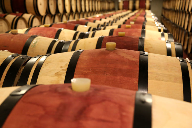 In A Row Large Group Of Objects Cellar Indoors  Wood - Material Food And Drink Arrangement Wine Cellar Selective Focus Drink Wine No People Wine Cask Refreshment Alcohol Repetition Winery Abundance Winemaking Barrel Order