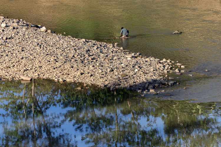 High angle view of man in river