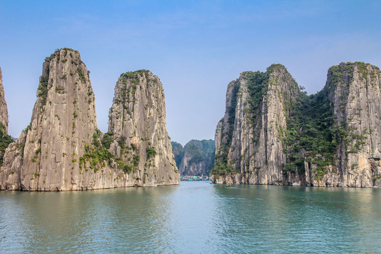 Halong Bay in Vietnam Halong Bay Vietnam Halong Bay  Halong Bay Cruise Vietnam Water Sky Rock Waterfront Beauty In Nature Scenics - Nature Rock Formation Rock - Object Tranquility Tranquil Scene Mountain Nature Day Solid No People Sea Non-urban Scene Clear Sky Idyllic Outdoors Formation Turquoise Colored View Into Land Eroded