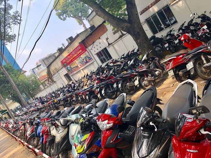 Scooter Parking - Saigon Parking Motorcycle Parking Lot Scooter Building Exterior Abundance Day Large Group Of Objects City Mode Of Transportation Motor Vehicle Transportation Land Vehicle