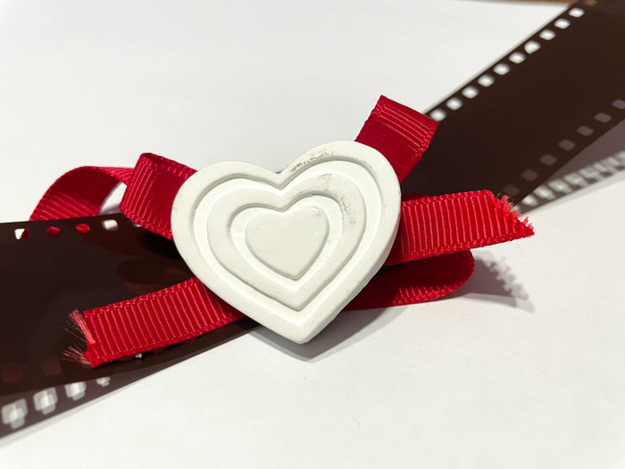 High angle view of heart shape on table against white background