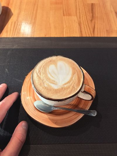 EyeEm Selects Drink Food And Drink Coffee - Drink Coffee Human Hand Refreshment Lifestyles Human Body Part Table Coffee Cup Cup High Angle View Frothy Drink One Person Indoors  Freshness Mug Unrecognizable Person Hand Hot Drink