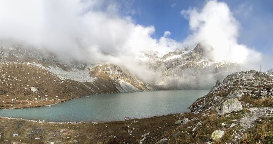 Through the clouds Snow Mountains Mountain Lake Water Cloudy Sky Meditating Nature Traveling No People Environment Nature Photography Nobody Caucasus Mountains Hiking Trail Cloudscape Tranquil Scene Inspirational View Beauty In Nature