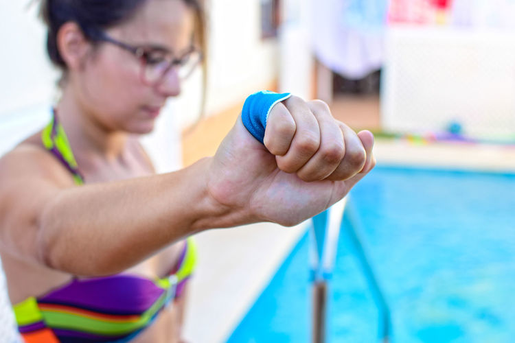 Midsection of woman holding swimming pool