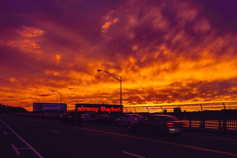Sunset Cloud - Sky Sky Dramatic Sky Orange Color Car Road Transportation Beauty In Nature Street Land Vehicle Nature Street Light Scenics No People Outdoors Architecture City