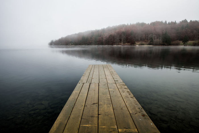 Amazing atmosphere in Slovenia Beauty In Nature Day Fog Jetty Lake Lake View Lakeside Lakeview Long Exposure Nature Nature Photography No People Outdoors Pier Scenics Sea Seascape Seaside Sky Slovenia Tranquil Scene Tranquility Tree Water Wood - Material