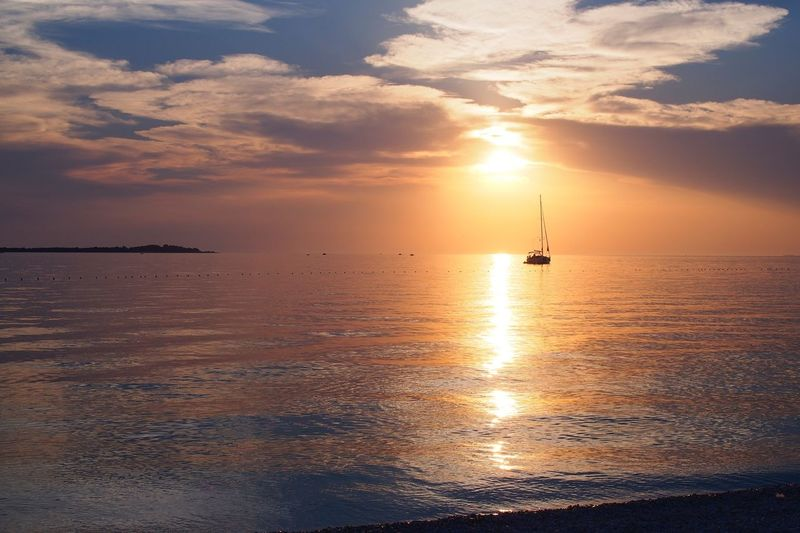 Golden sunset Sunset Sea Scenics Sky Horizon Over Water Sun Beauty In Nature Cloud - Sky Water Nature Nautical Vessel Orange Color Tranquility Reflection Tranquil Scene Sunlight Transportation Mode Of Transport No People Idyllic Sunset_collection Sunsets Golden Sunset Water Sunset Over Water