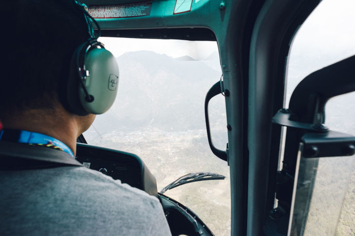 Coming in for landing at Lukla Airport. Landing The Week on EyeEm Airplane Cockpit Day Driving Flying Glass - Material Headset Headshot Men Mode Of Transportation One Person Outdoors Over The Shoulder View Pilot Piloting Portrait Real People Rear View Sitting Transportation Travel Vehicle Interior Windshield