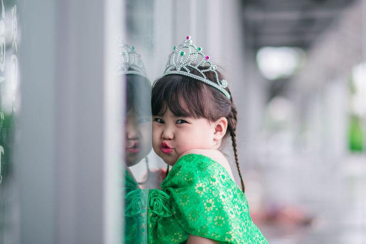Portrait of cute girl wearing crown