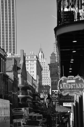 New Orleans . City Architecture Building Exterior Skyscraper Outdoors Text Travel Destinations Built Structure City Life Cityscape Day Business Finance And Industry Modern Urban Skyline No People Sky