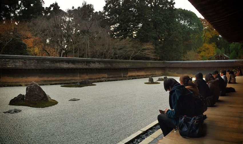Tourists enjoy the zen at the Ryoanji Temple's Rock Garden in Kyoto Traveling Kx2014