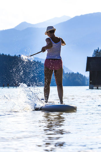 SUP-Paddling at the Walchensee in Bavaria Alps Ammersee Bavaria Boat Fun Garmisch Garmisch-partenkirchen Having Fun Herzogstand Holiday Lifestyle Mittenwald Mountain Range Outdoors Paddling Silhouette Sports Sup Tegernsee Vacation Vacations Walchensee Water Werdenfels Woman