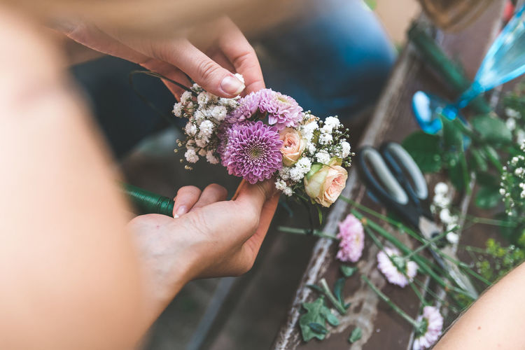 Flower Wreath Flower Flowering Plant Plant Human Hand Hand Holding Human Body Part Freshness Real People Women Nature Adult Vulnerability  Fragility One Person Beauty In Nature Day Flower Head Focus On Foreground Bouquet Flower Arrangement Outdoors Purple