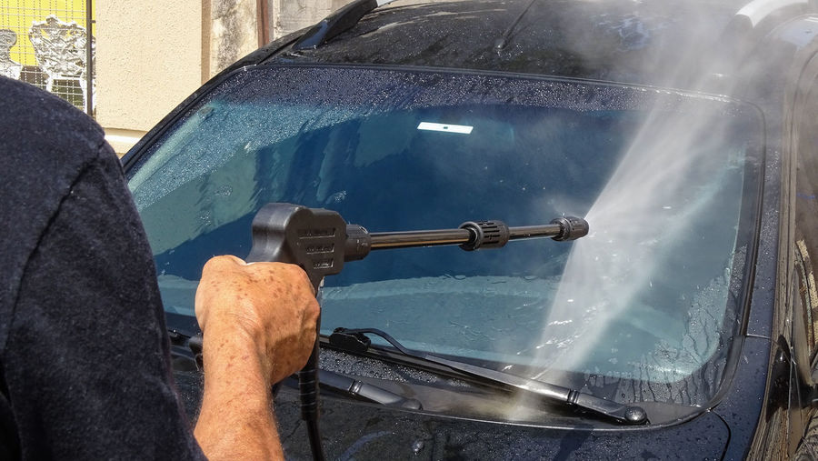 ezefer Car Wash Car Washing Car Day Glass - Material Hand Holding Human Body Part Human Hand Human Limb Lifestyles Men Mode Of Transportation Nature Occupation One Person Outdoors Real People Transportation Water Window Working