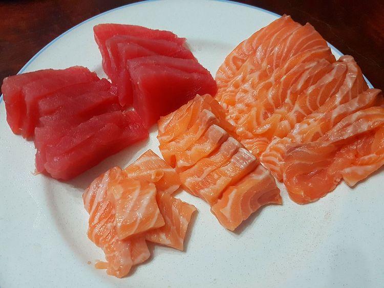 Indoors  Close-up Human Hand Human Body Part People Food One Person Ready-to-eat Day Freshness Sashimi Sushi Salmon Sashimi