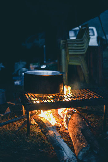 View of cooking utensil on flame outdoors