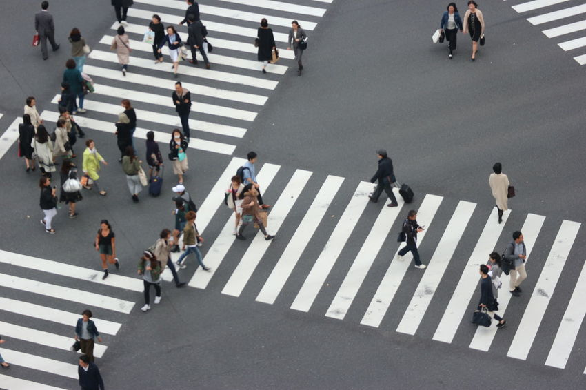 people crossing the intersection street at ginza Business Busy Japan Rush Hour Tokyo Traffic City City Life Crossing Crosswalk Crowd Ginza Group Of People High Angle View Large Group Of People Lifestyles Outdoors Real People Road Road Marking Salarymen Street Transportation Walking Zebra Crossing