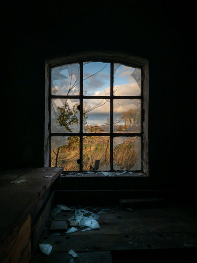 View of abandoned house through window