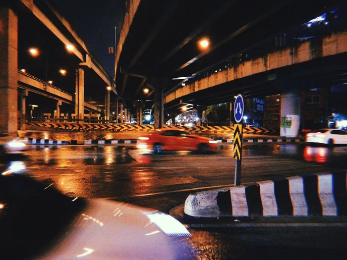 Cars on road in city at night