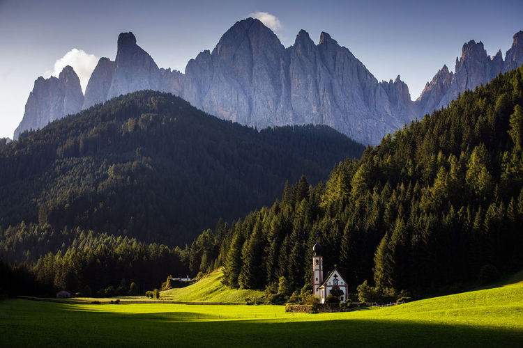 Ranui church from dolomites with scenic view of mountains against sky