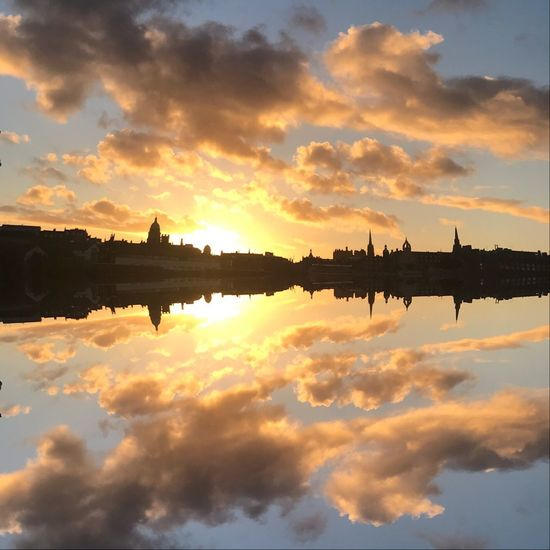 Sky Cloud - Sky Sunset Reflection Water Silhouette Nature Building Exterior Beauty In Nature Transportation Outdoors Built Structure Standing Water Waterfront Orange Color Symmetry Architecture No People Lake