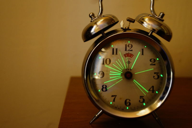 Close-up of clock hanging at home