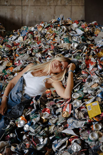 High angle view of woman lying down on garbage