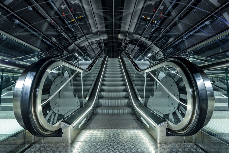 Escalator Hafencity Hamburg Subway Station Nightphotography Terminated Indoors  Escalator Metal Transportation Architecture Staircase Steps And Staircases No People Modern Illuminated Convenience Built Structure Futuristic Pattern Empty Silver Colored Technology Railing Absence The Way Forward Ceiling Wheel