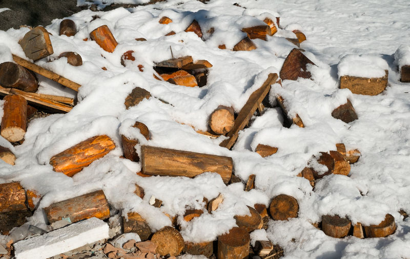 a pile of broken wood covered in snow Pile Of Wood Broken Wood Covered In Snow Snow Cold Temperature Winter No People Nature Day Covering White Color Wood - Material High Angle View Large Group Of Objects Field Abundance Outdoors Frozen Land Beauty In Nature Food Tree My Best Photo