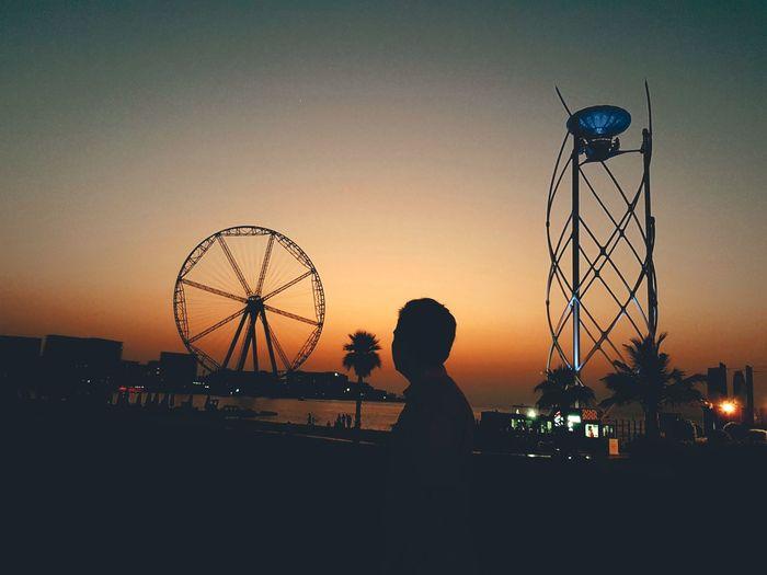 sunset x shadow × people EyeEm Nature Lover Eyemphotography EyeEm Dubai Beach Nightlife Nightlights Shadow Sunset_collection Silhouette City Astronomy Sunset Silhouette Ferris Wheel Child Sky Rollercoaster Coast