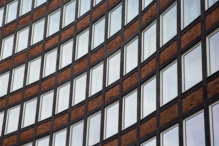 Full Frame Pattern No People Low Angle View Architecture Window Backgrounds Built Structure Building Building Exterior Repetition Day Shape Outdoors In A Row Design Wall - Building Feature Glass - Material Close-up Brick Windows Lines, Shapes And Curves Geometric Shapes Urban Urban Geometry Many Curved Lines Curved
