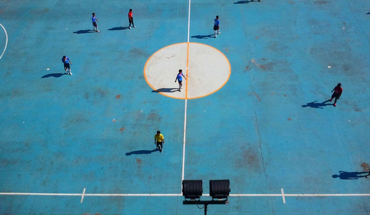 High angle view of young people playing soccer