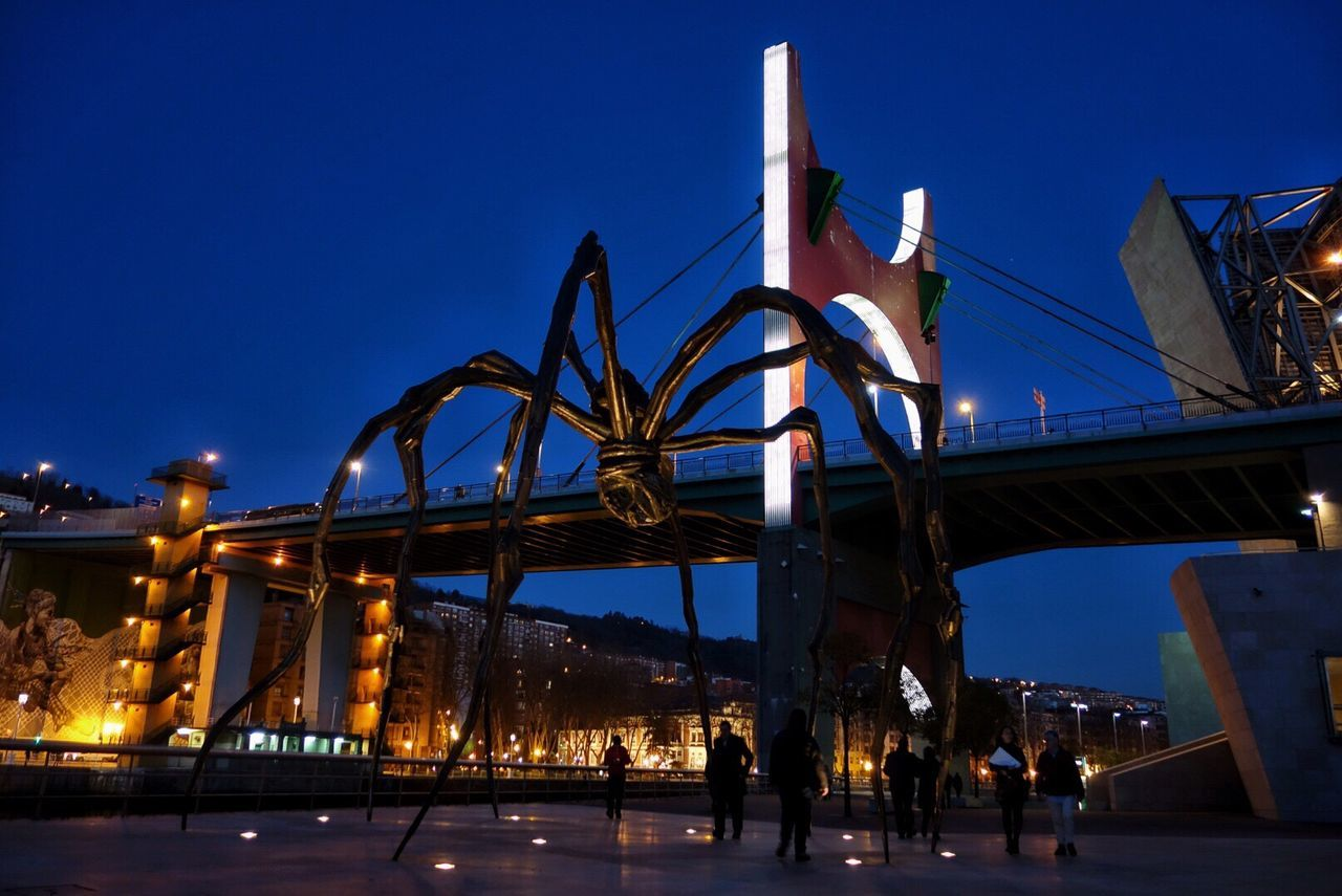 connection, bridge - man made structure, built structure, blue, architecture, low angle view, clear sky, outdoors, sky, illuminated, travel destinations, night, city, no people