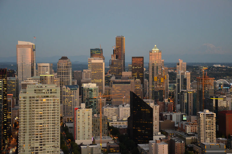 High Angle View Of Skyscrapers In City During Sunset