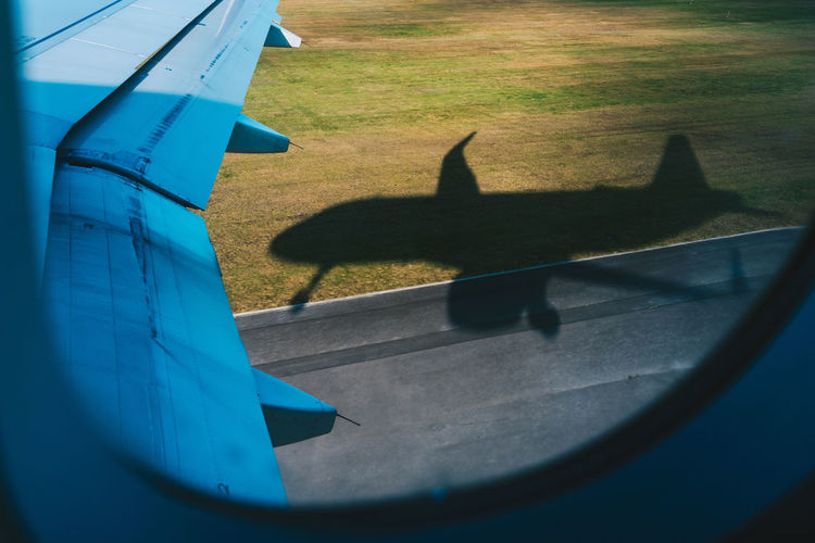 Shadow of airplane seen through window